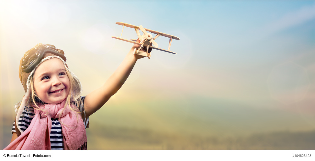 little girl with airplane.jpg